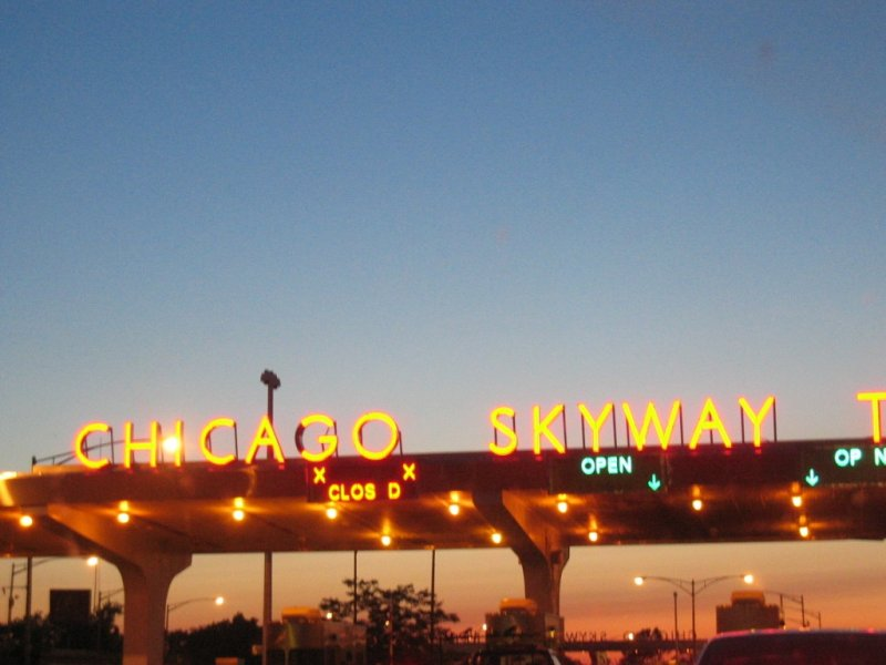 Night view of the Chicago Skyway tollbooths at the entrance to Chicago's southern city limits
